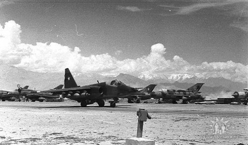 Soviet Su-25 Frogfoot-A taxiing out in front of Afghan Air Force Su-22M Fitter-J and 27th Guard Fighter Air Regiment's MiG-21bis Fishbed-L in Bagram airport in 1982.