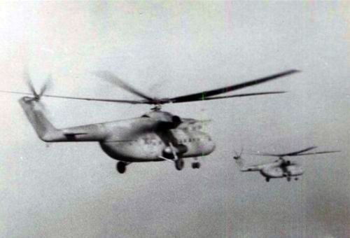 Soviet 688th Independent Helicopter Regiment's Mi-6 Hook heavy cargo helicopters in the sky. Each squadron used an average of 10 large transport helicopter.