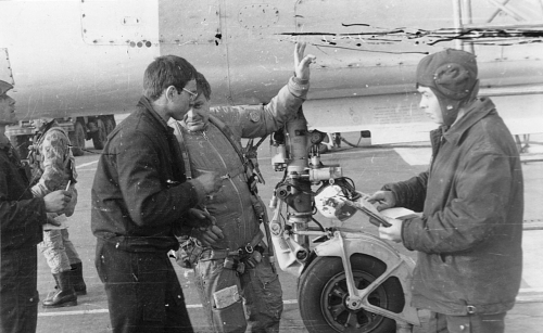 Soviet Tactical Air Force's 7th Bomber Air Regiment, Starokonstaninov ground crew and pilot front of his Su-24M Fencer-D