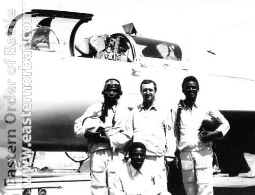 Congolese pilots and their soviet instructor in front of silver color MiG-21UM Mongol-B. Photo: Valery Okheretko