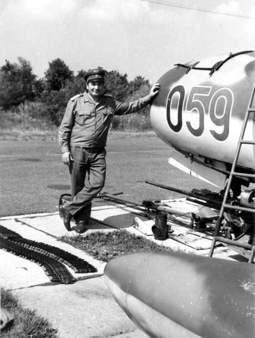 Colonel Janos Holler the 101st Reconnaissance Air Regiment commander next to his MiG-15bis Fagot-B aircraft
