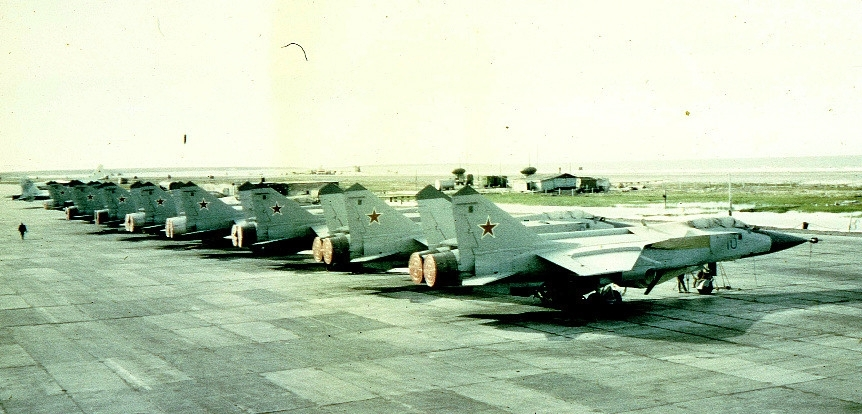 The first MiG-31 'Foxhound' air defence fighter arrived to 72nd Guard Fighter Air Regiment PVO at Amderma in 1986. On the photo: eight MiG-31 at the Amderma airport in early nineties.