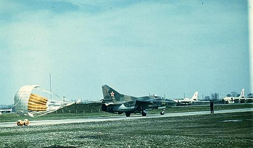 The 179th Fighter Bomber Air Regiment's MiG-23UB Flogger-C type is rolling in front of the 260th Long Bomber Regiment's bomber Tu-16s at Striy airport.
