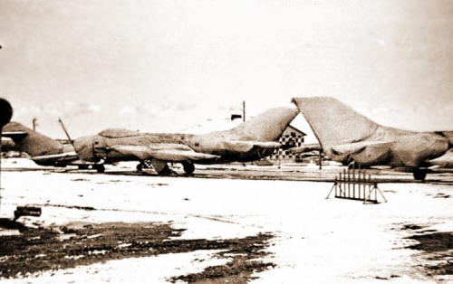 Soviet MiG-19 Farmer interceptors and MiG-17 Fresco trainer aircraft at Afrikanda airport in winter