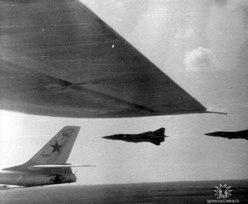 The 678th Guards Mixed Test Air Regiment's Tu-16 'Badger' and MiG-23 'Flogger' aircraft over the Kazakh desert.