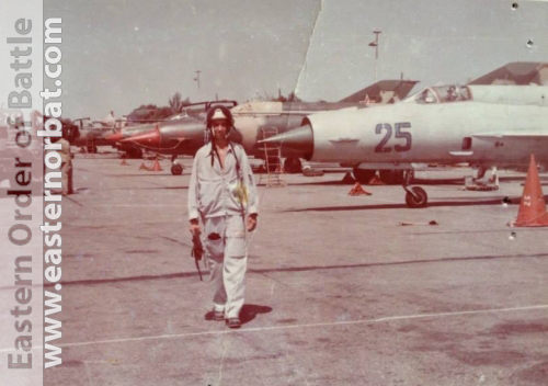 Foreign pilot in 322nd Training Air Regiment in Kant airbase in front of grey MiG-21bis, and other colorfull camouflage MiG-21s in the eighties.